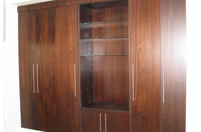 Converted wall unit featuring glass shelving