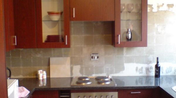 Mottled mahogany melamine kitchen