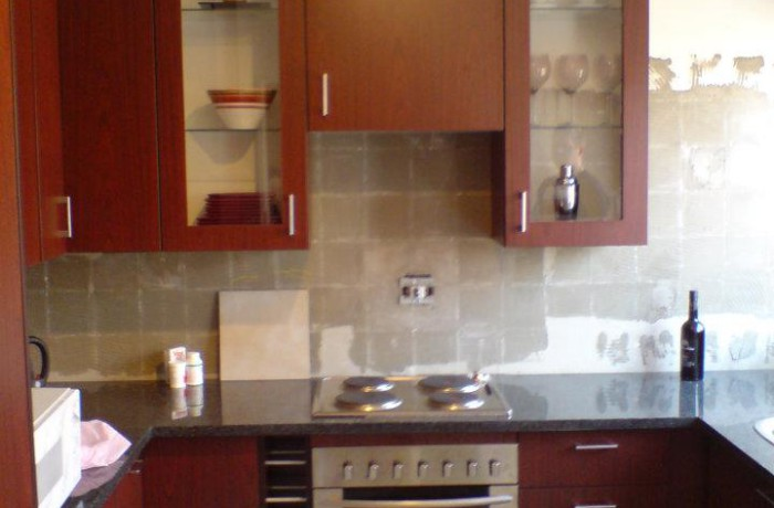 Mottled mahogany melamine kitchen