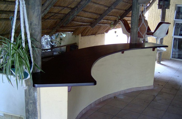 Outdoor bar with Meranti curved top