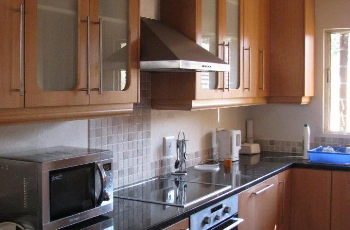 Beech wood kitchen with Rustenburg black top